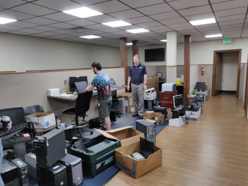 Two BTS workers working on donated computers, so they can be donated to charity