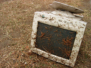 Old CRT monitor covered in debris
